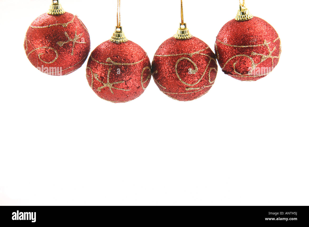 four red christmas decoration balls hanging isolated on white background front view Stock Photo