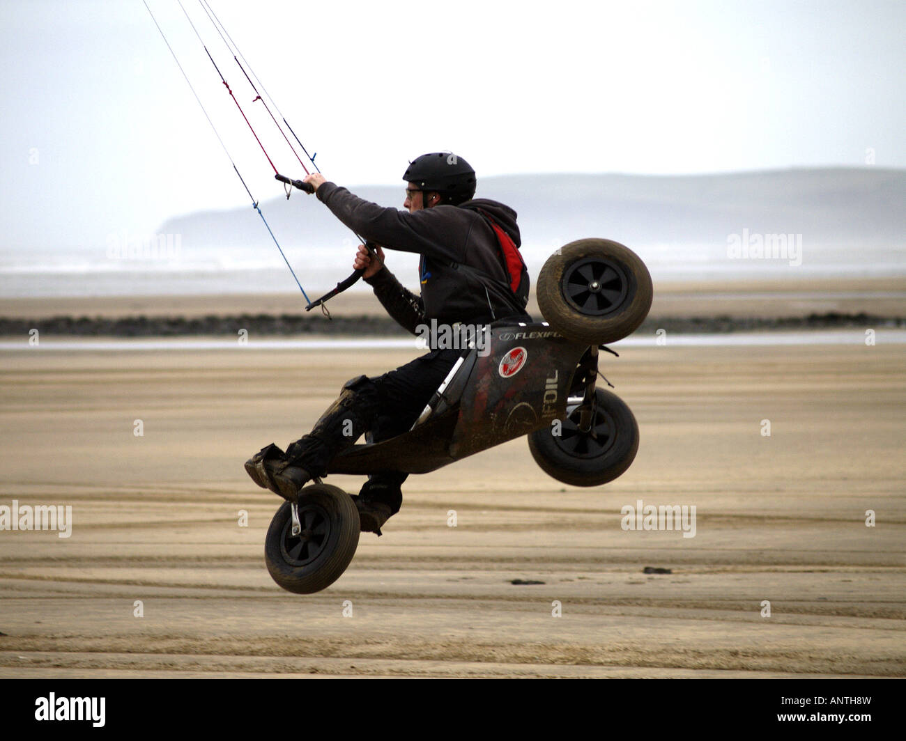 A parakarter doing tricks in the air. Stock Photo