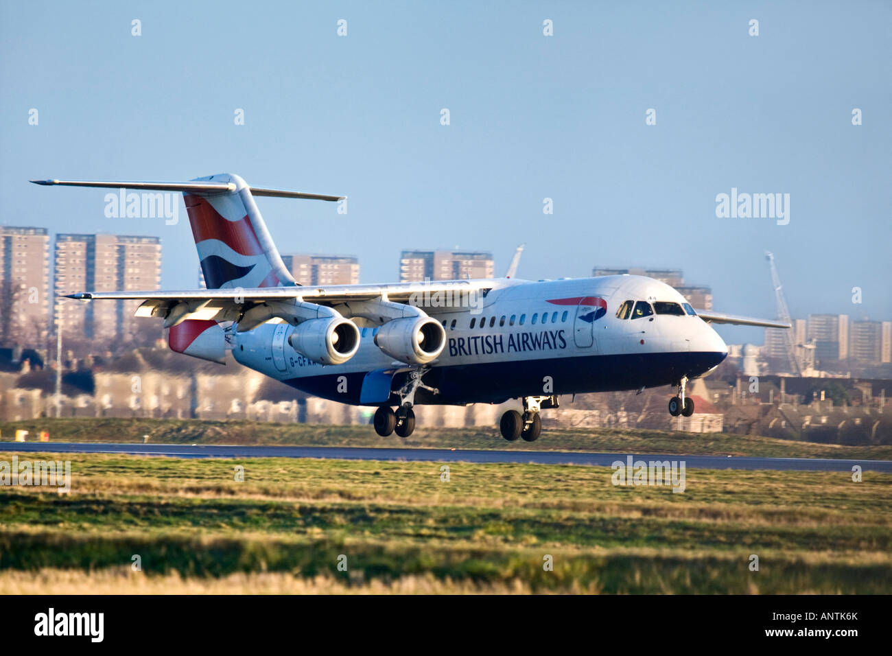 A British Airways BAE Systems Avro 146 RJ100 landing. - Stock Image