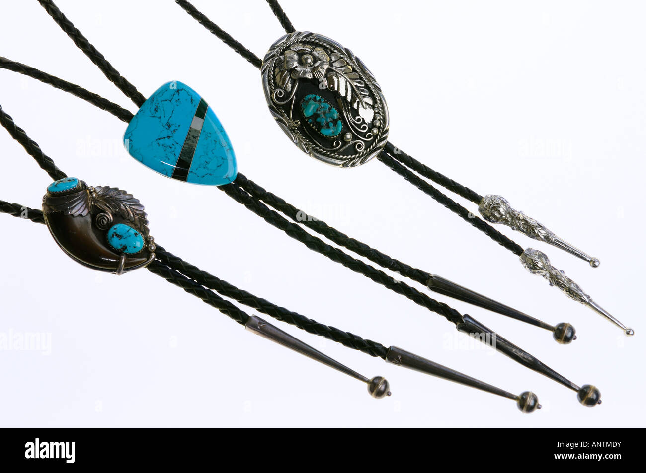 Three bolo ties with turquoise stone inlay on white background - Stock Image