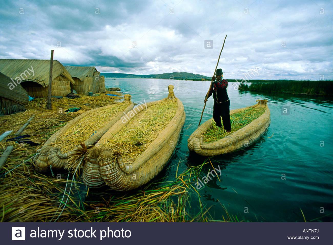 Reed boats of the Uro Indians on Santa Maria Island floating island Lake Titicaca Peru - Stock Image
