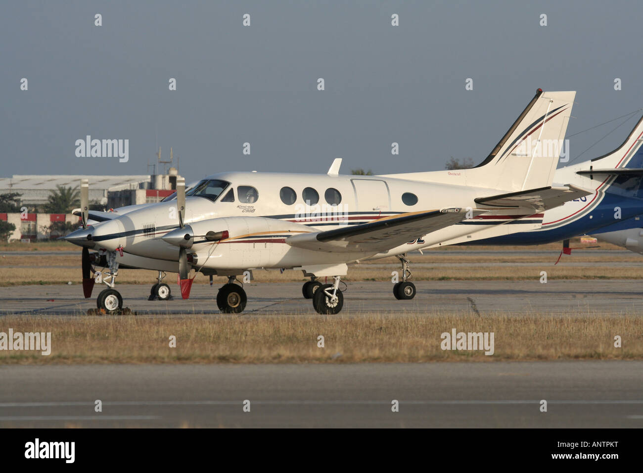 Beech C90B King Air turboprop commuter plane parked at airport apron - Stock Image