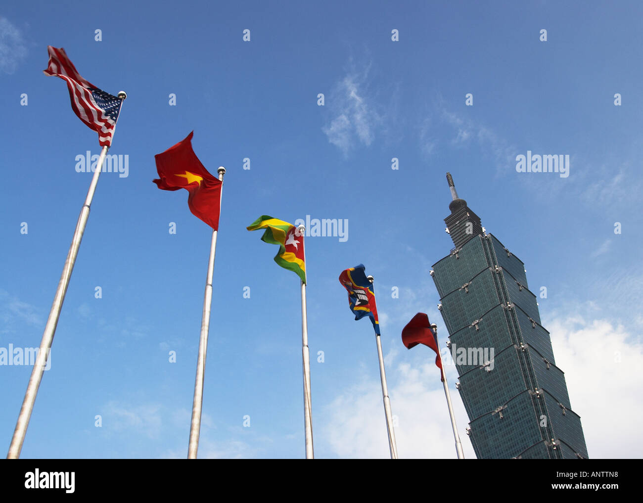 Taiwan, Flags Flying Outside Taipei 101 Stock Photo