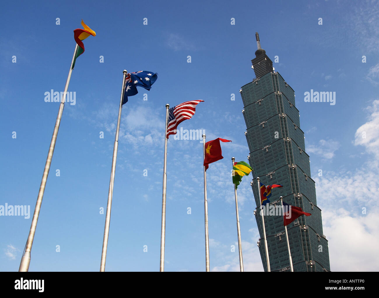 Flags Flying Outside World's Former Tallest Building, Taipei 101 Stock Photo