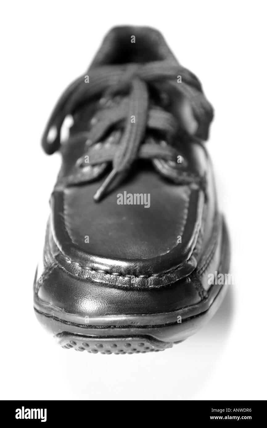 Black shoe on white background - Stock Image