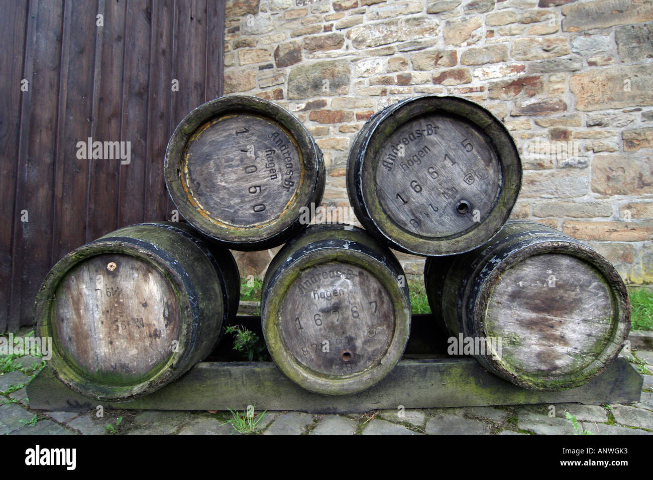 Old beer barrels, stacked - Stock Image