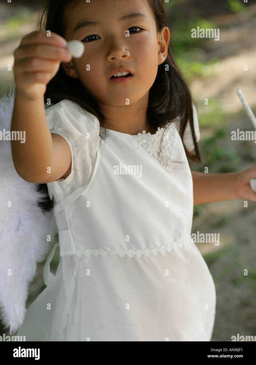 High angle view of a girl dressed as a fairy - Stock Image