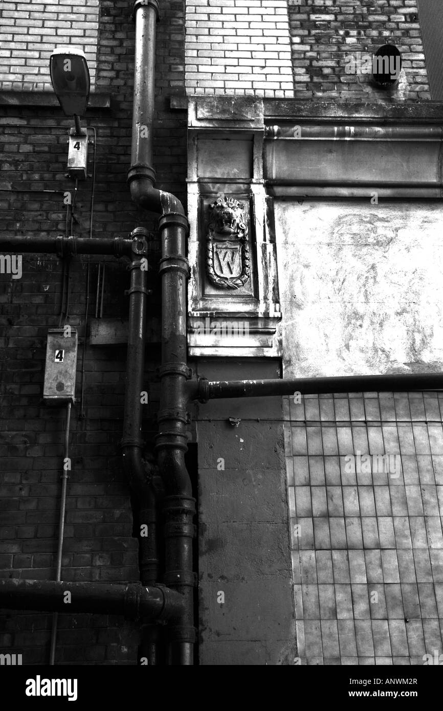 Manchester gargoyle in an alley joining Spear Street and Oldham Street at the back of the Nobles Amusements buildings - Stock Image