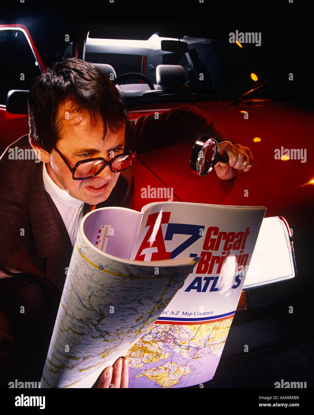 Man lost in the dark as he doesn't have satellite navigation - Stock Image