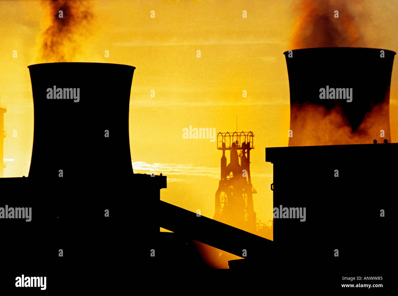 Sunrise over water cooling towers at British Steelworks Llanwern Wales - Stock Image