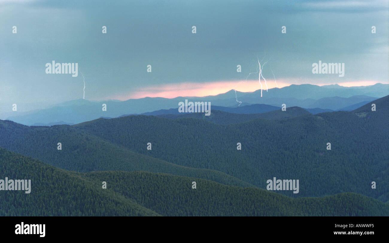 A flash of lightning over the Kuray Range. Altai. Siberia. Russia - Stock Image