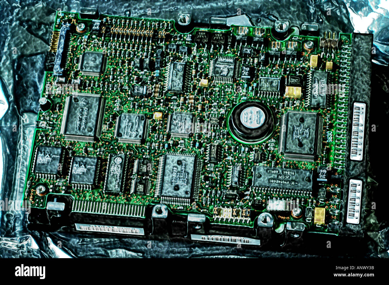 computer chip mother board showing electronic circuits diodes transistors - Stock Image