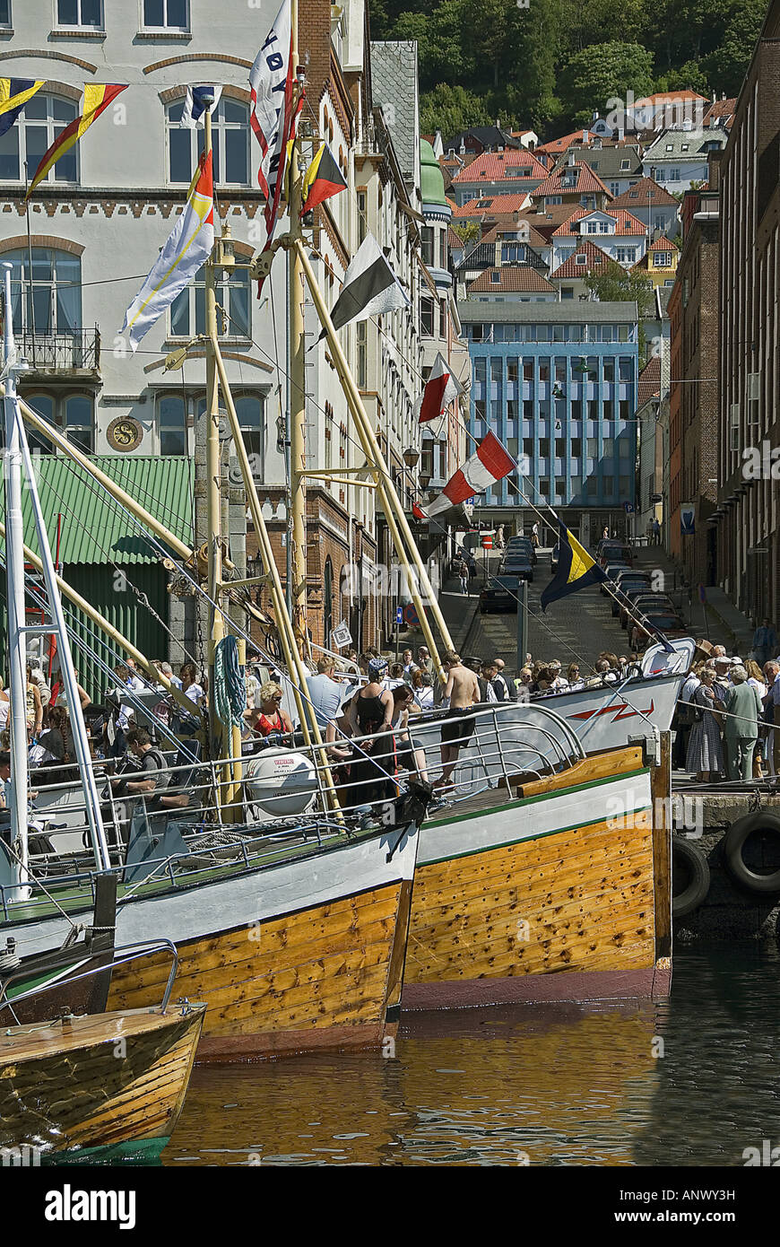 Old ships and people in the centre of Bergen, Norway, Bergen - Stock Image