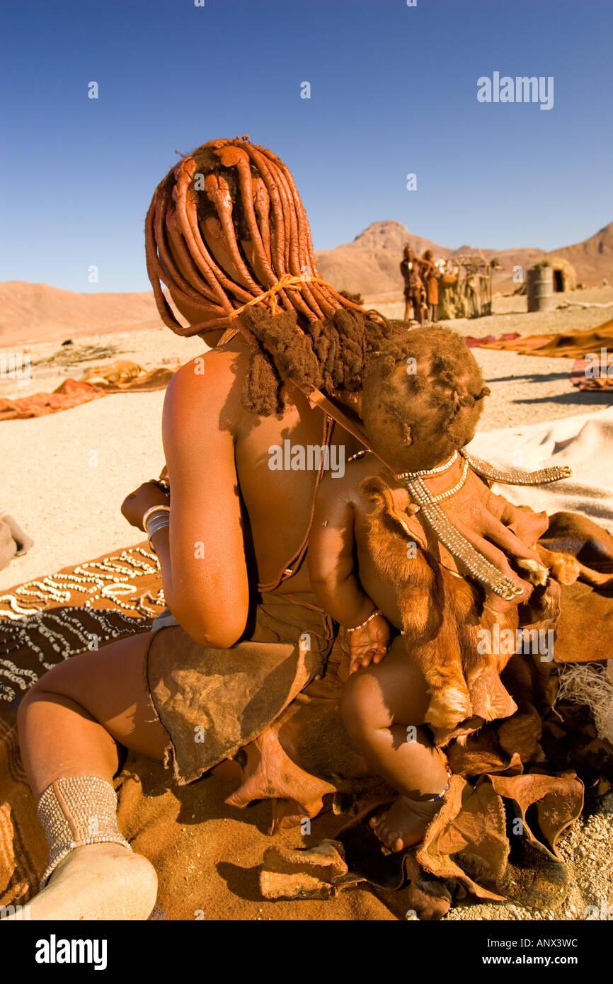 namibia skeleton coast himba tribe in dailing activities stock