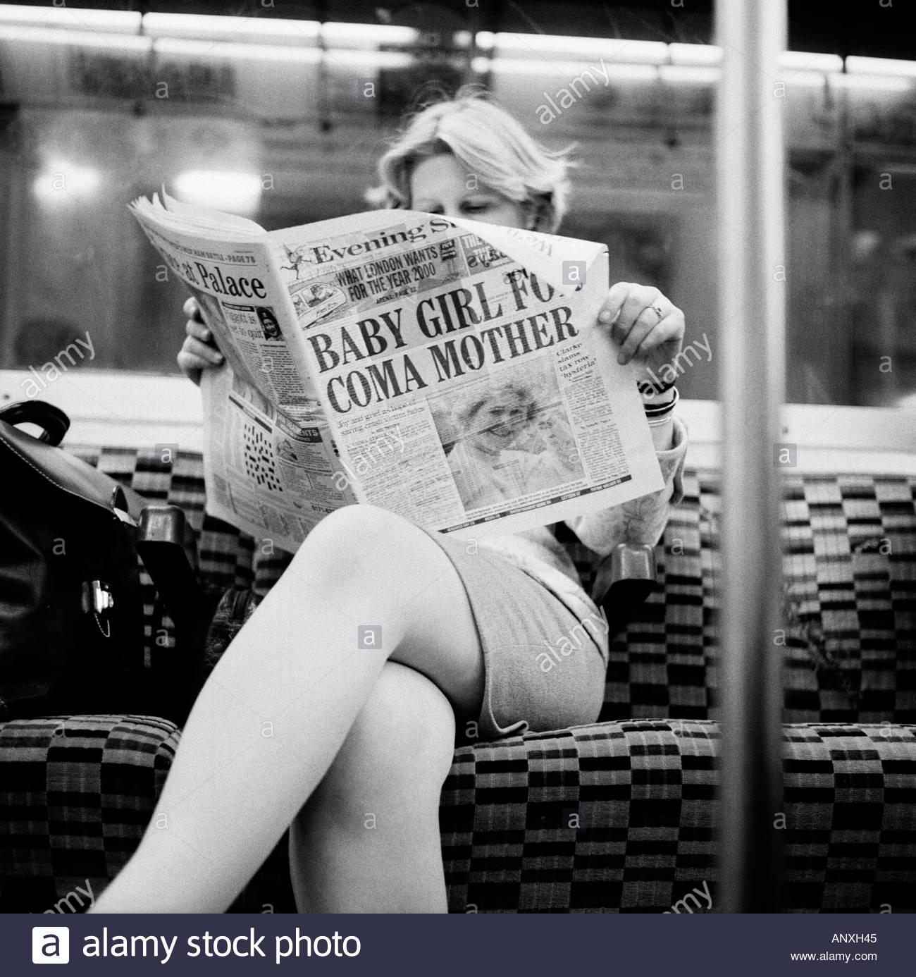 Woman reading London Evening Standard Newspaper on the ...