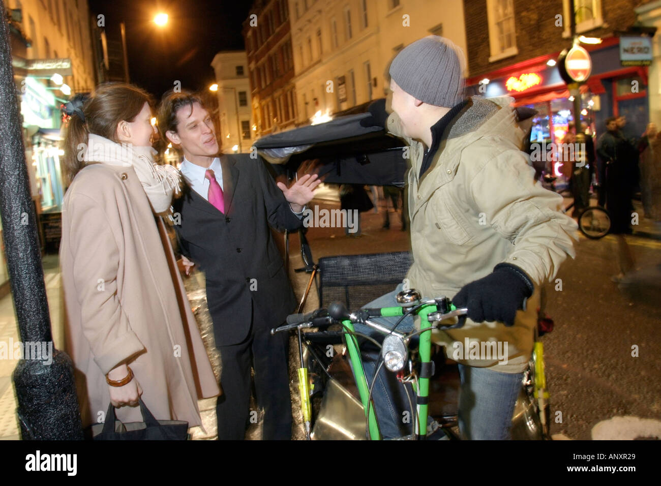 Couple on a Friday Night out in the West end of London Model released Rickshaw JUSTIN LEIGHTON - Stock Image