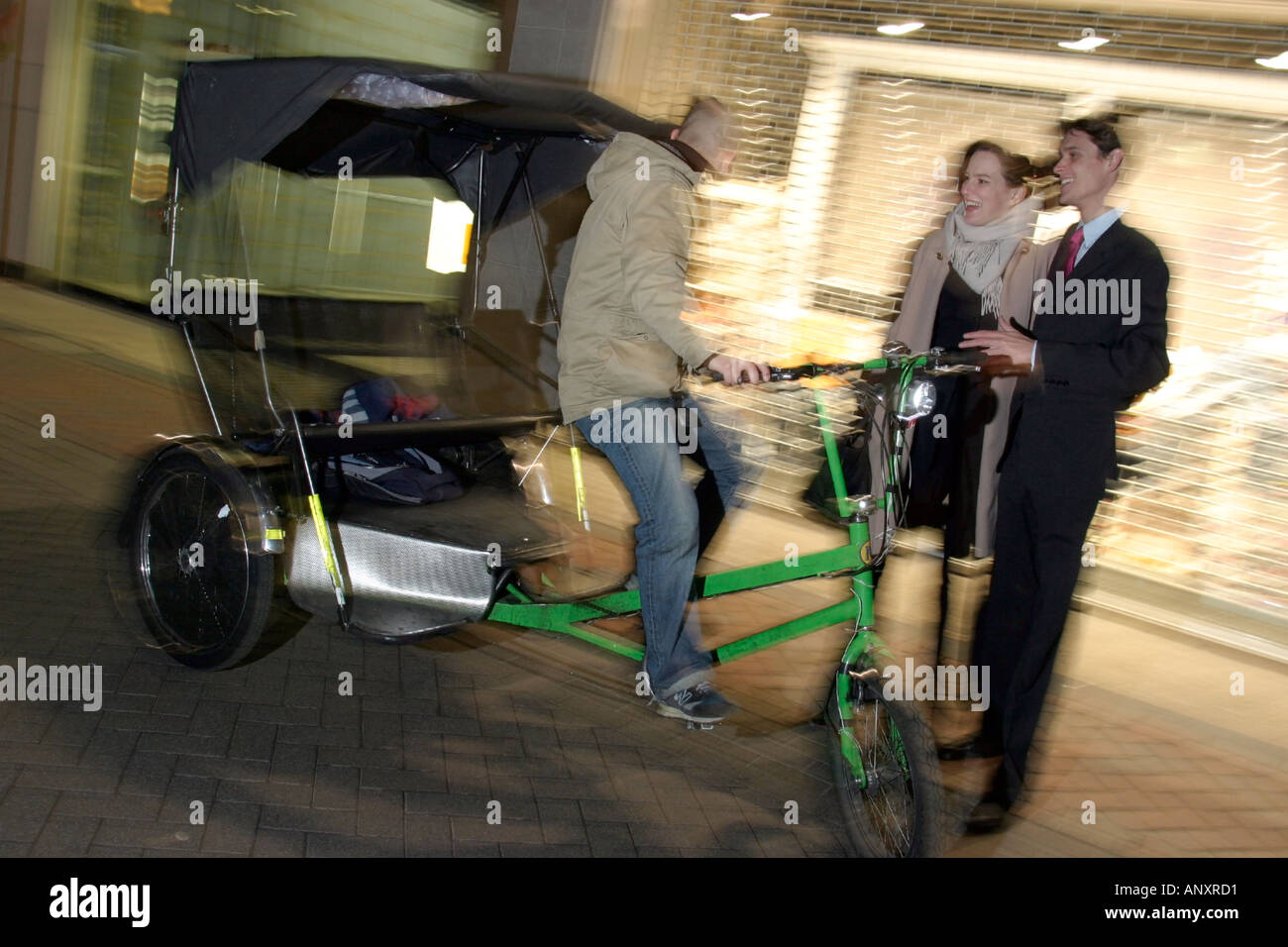 Couple on a Friday Night out in the West end of London Model released rickshaw - Stock Image