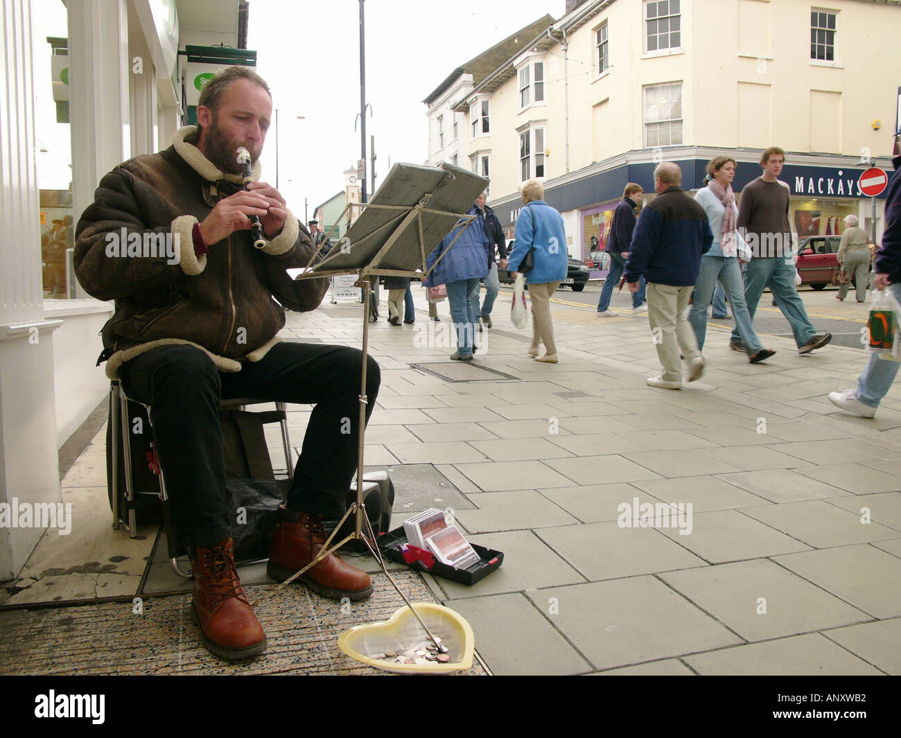 Busker Playing Recorder Great Darkgate Street Aberystwyth Ceredigion West Wales Stock Photo