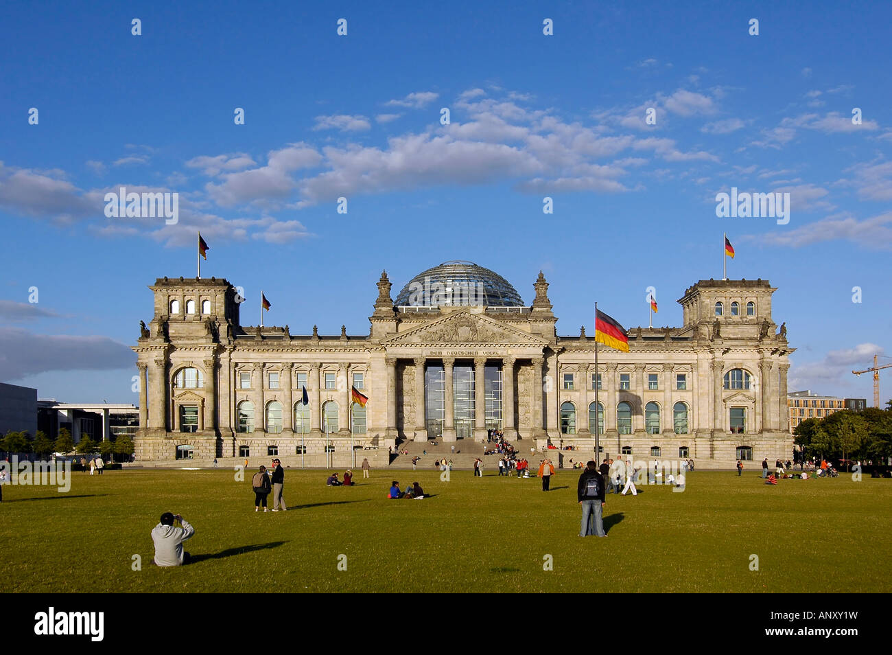 The Reichstag building and its park in Berlin, Germany. This building hosts the German parliament and is a symbol - Stock Image