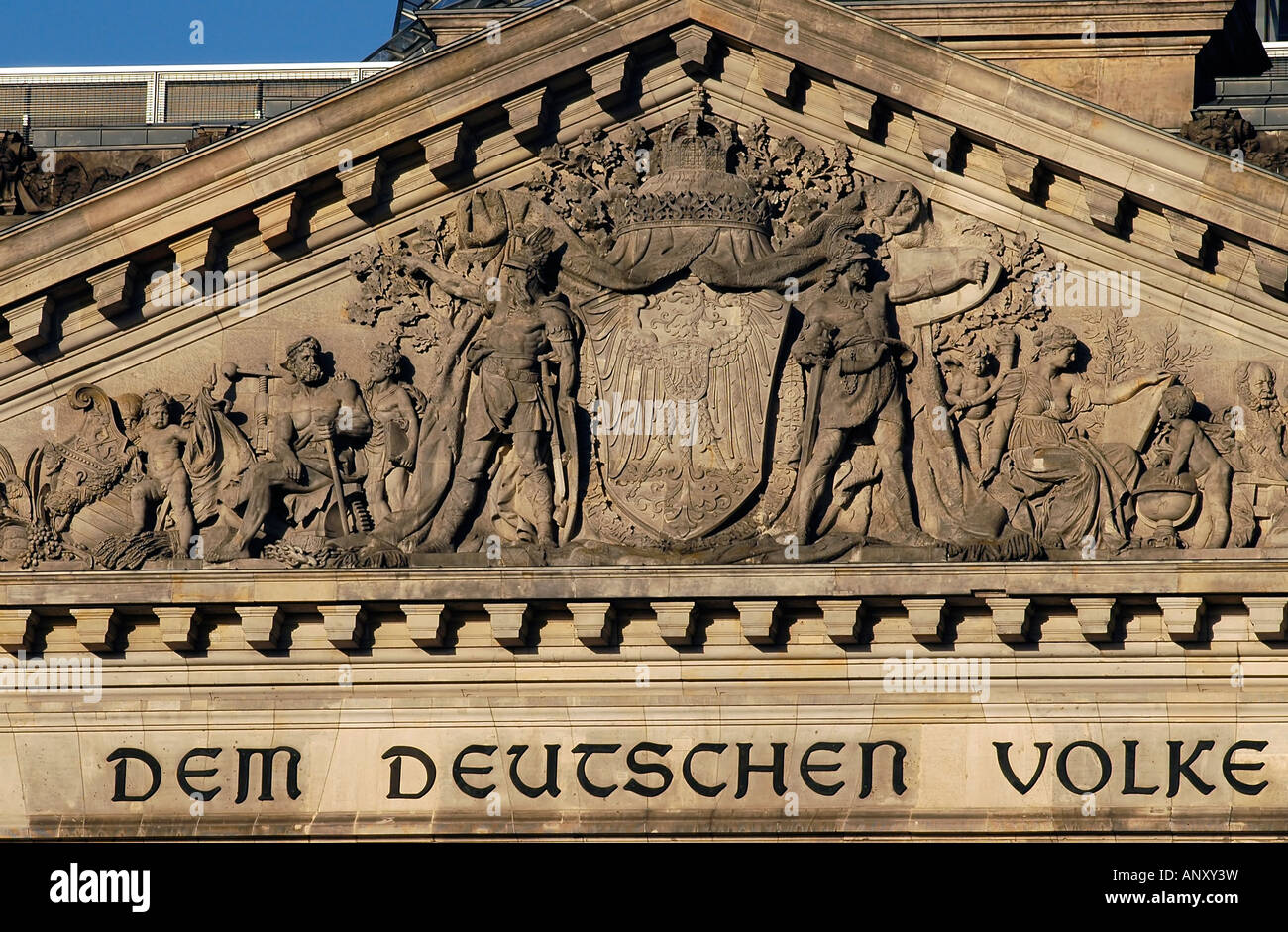 Close-up details of the facade of the Reichstag building in Berlin, reading 'The German People'. - Stock Image