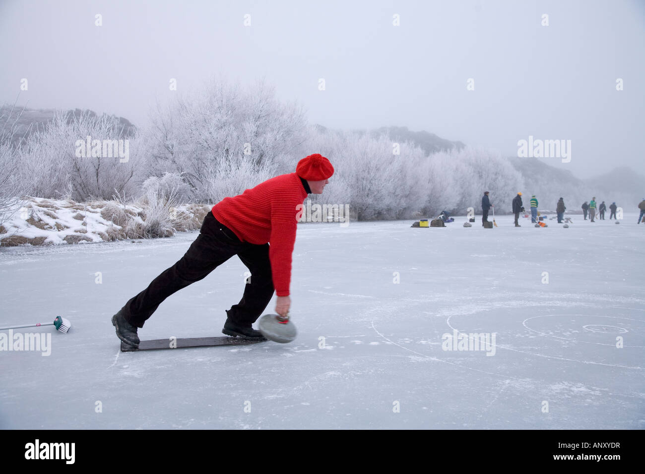 Mid winter curling on the Ida dam, Central Otago, New Zealand - Stock Image