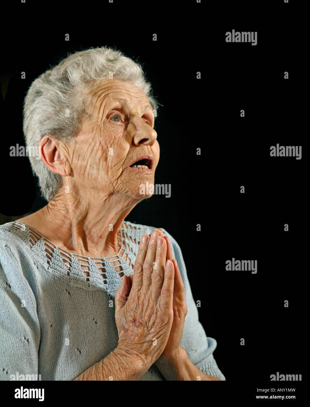 Senior Citizen Praying to the Lord - Stock Image