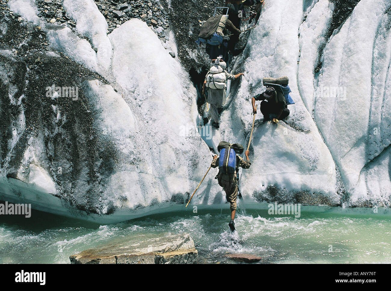Balti porters climbing in the snow K2 Pakistan - Stock Image
