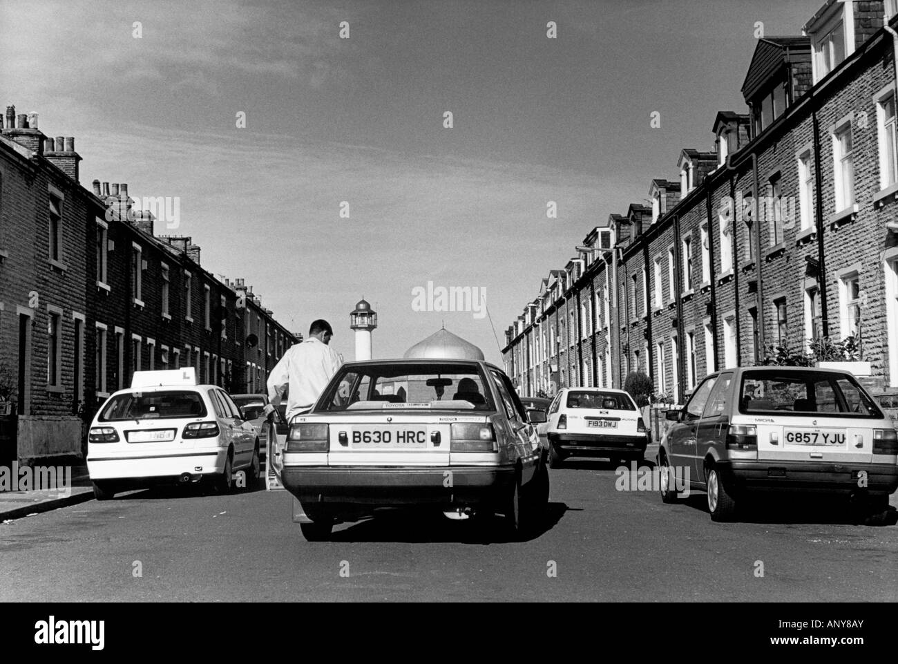 Traffic with the Lumb lane Mosque in the distance. Manningham, Bradford, Yorkshire, UK - Stock Image