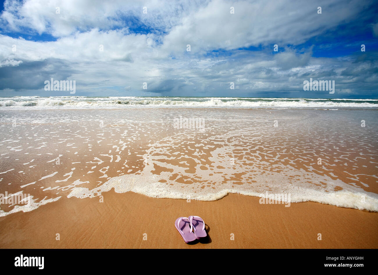 flip flop in front of the sea of sitio do conde in bahia state brazil - Stock Image