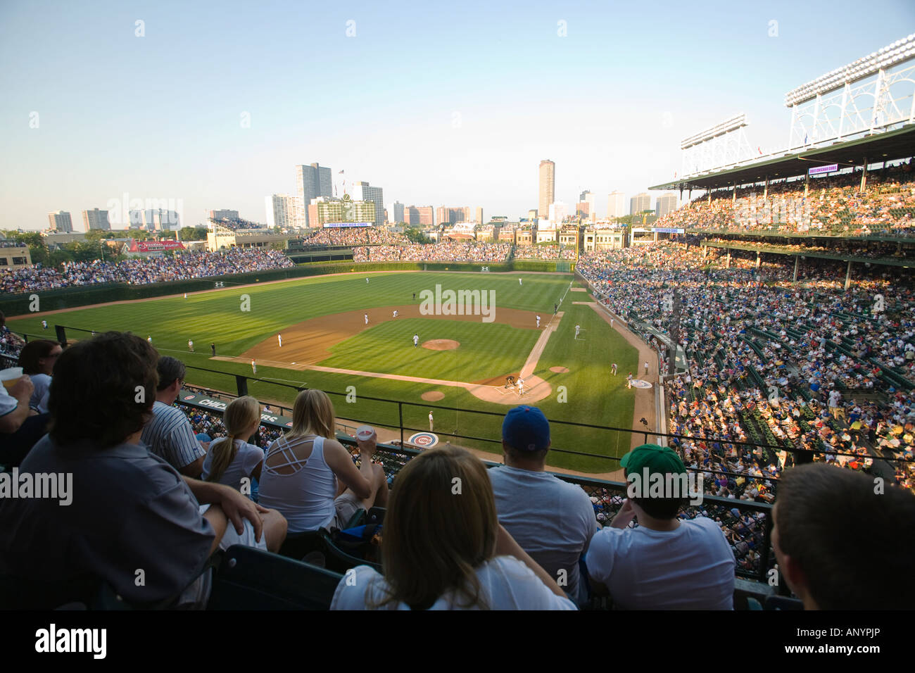 ILLINOIS Chicago Crowd in stands at Wrigley Field watching night game stadium for Chicago Cubs professional baseball - Stock Image