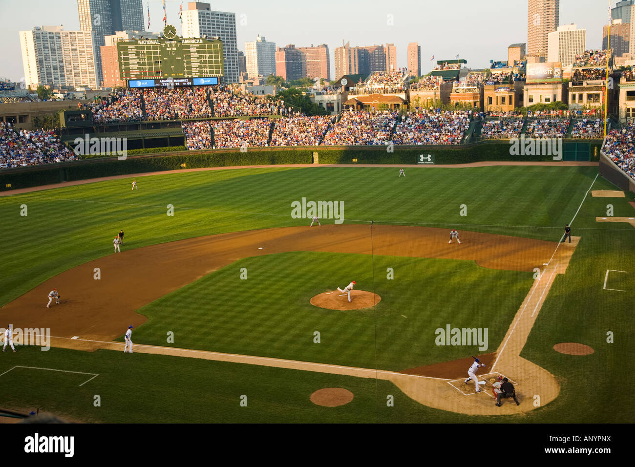 ILLINOIS Chicago Crowd in stands Wrigley Field watching night game stadium Chicago Cubs baseball team bleachers - Stock Image