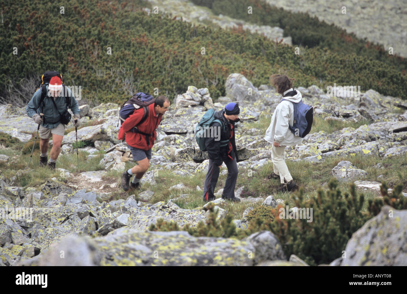 Group of people walking in Bezbog area Pirin National Park Bulgaria - Stock Image