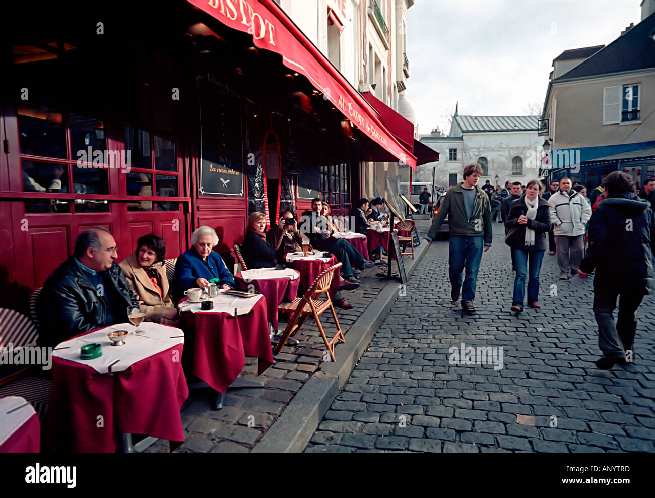 Visitors and tourists in Montmartre enjoy the cafe terraces or a morning stroll in this historic district of Paris Stock Photo