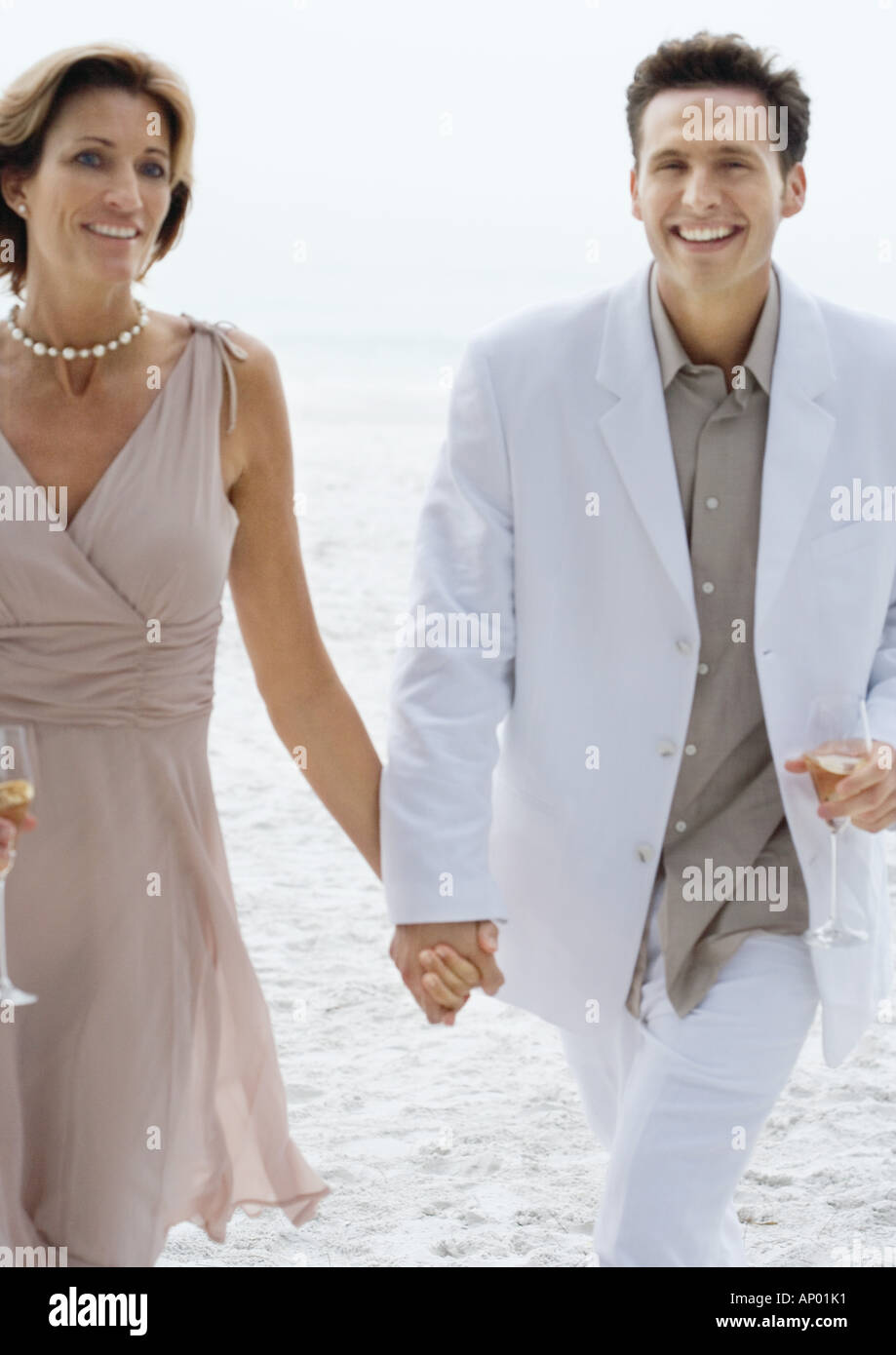 Couple in formalwear on beach - Stock Image