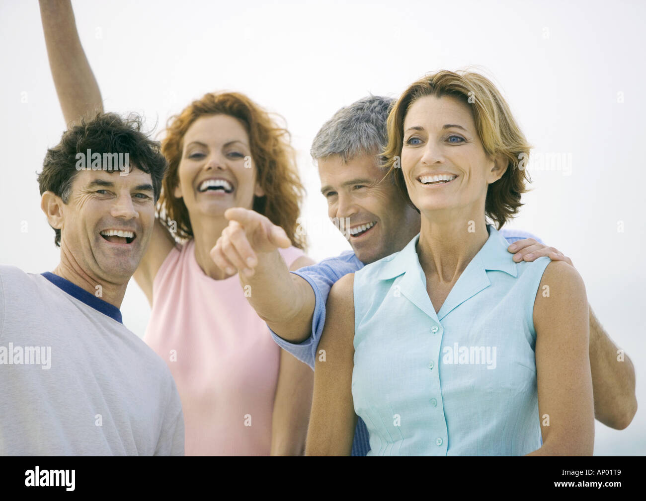 Two mature couples laughing - Stock Image