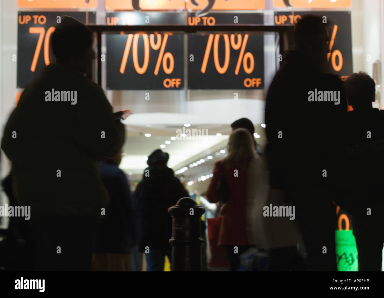 Shoppers waiting in front of store during sales - Stock Image