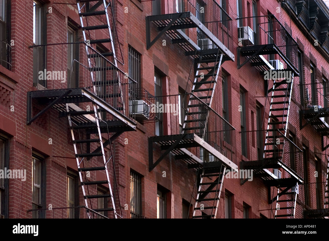 RED BRICK BUILDING And BLACK METAL FIRE FIRE ESCAPE STAIRS N MANHATTAN NEW  YORK CITY NEW