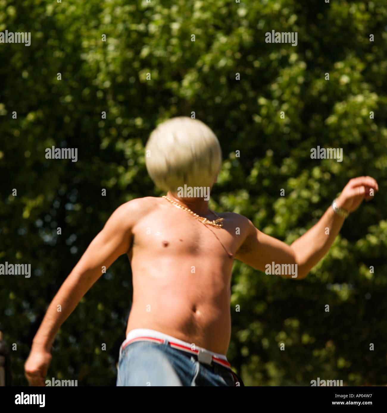footballer summer park life.No model release required: head crop so unrecognizable - Stock Image