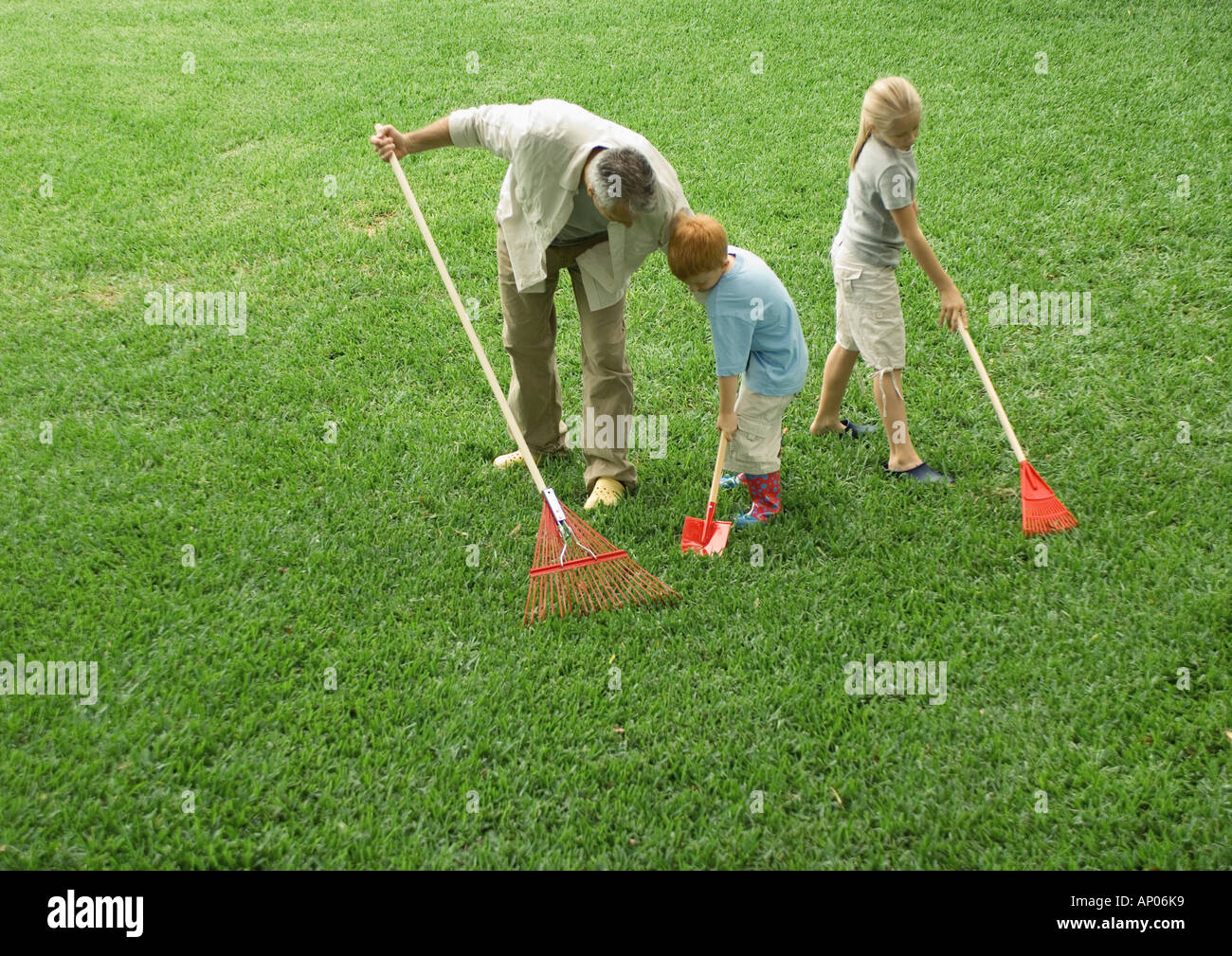 Father and children working in the yard - Stock Image