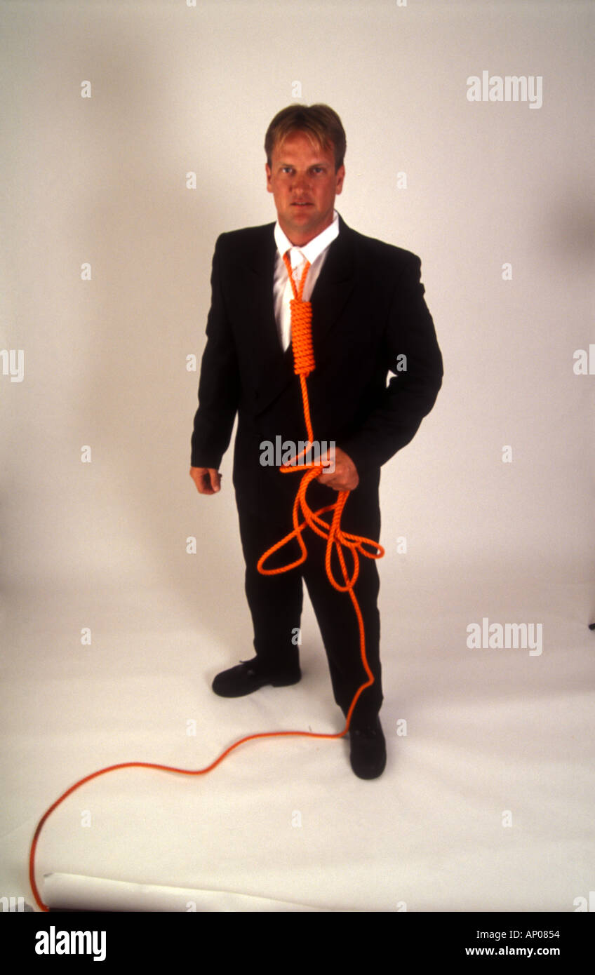 Necktie party going to work with a noose around your neck man tied up and in danger from himself suicide self abuse Stock Photo