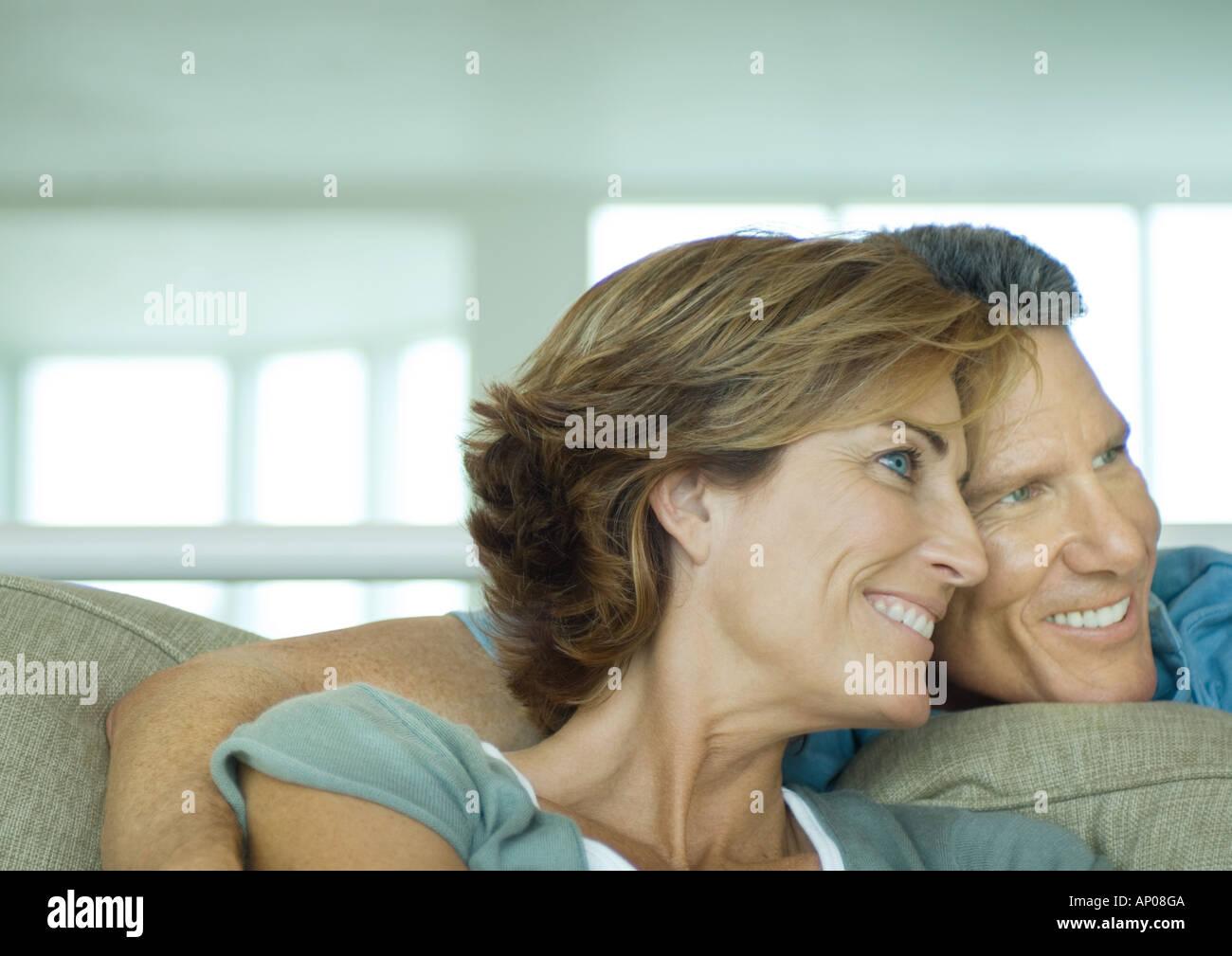 Mature couple smiling, cheek to cheek - Stock Image