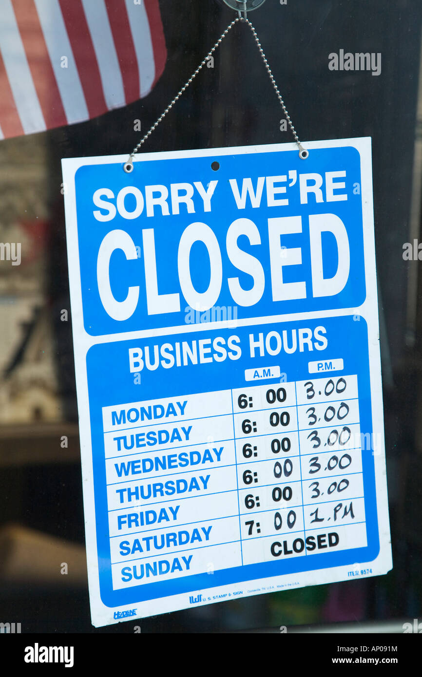 ILLINOIS Chicago Sorry we are closed sign hanging in window business hours and times information for retail store - Stock Image