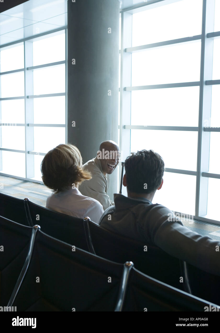People in airport lounge - Stock Image