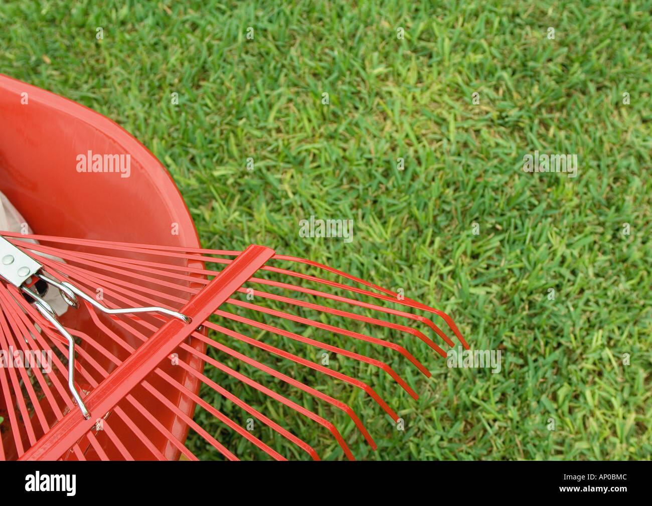 Rake and wheelbarrow, partial view - Stock Image