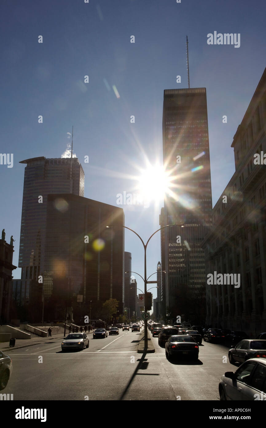 Wide street looking into the sun. International Quarter, Montreal, Quebec, Canada - Stock Image