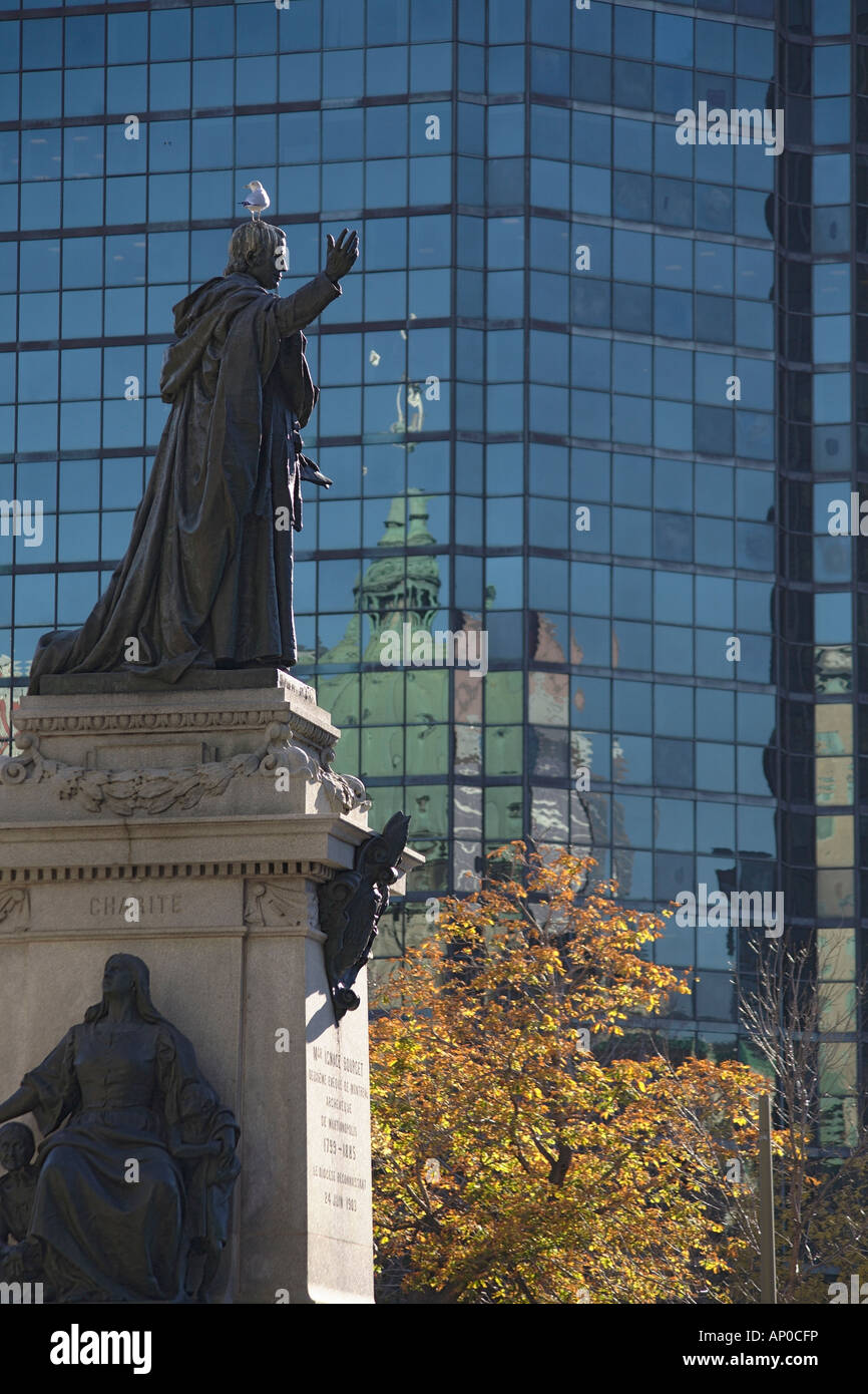 Statue of Ignace Bourget with seagull on its head. International Quarter, Montreal, Quebec, Canada - Stock Image