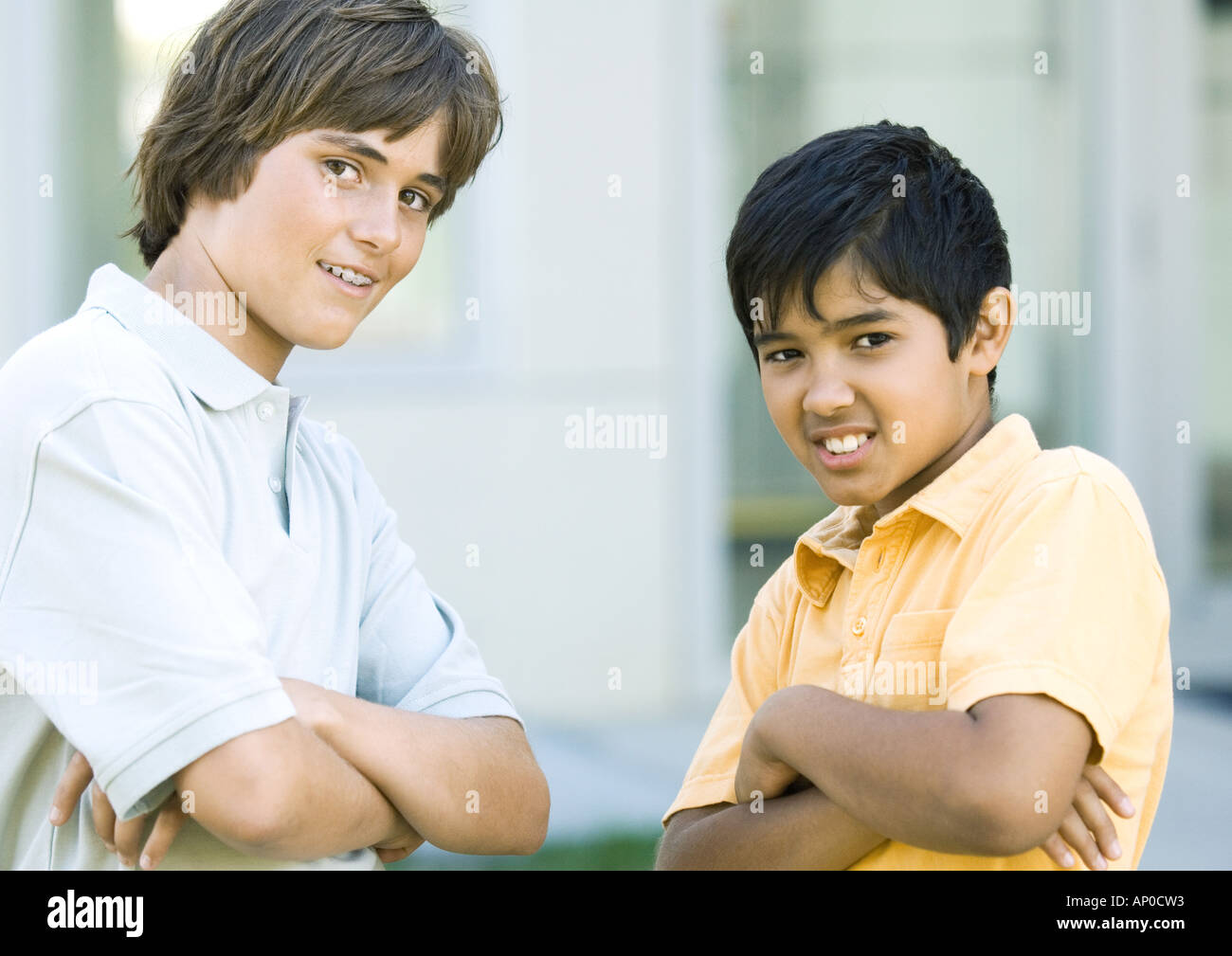 Preteen boys with arms crossed - Stock Image