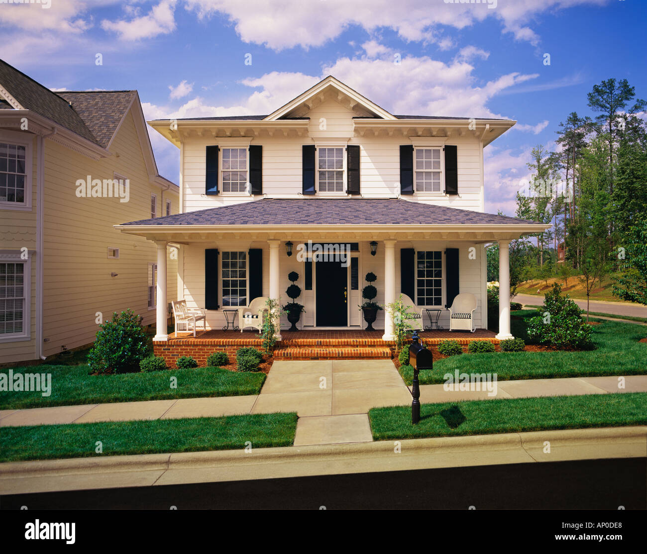 Small Two Story White House With Black Shutters Brick Porch Stock
