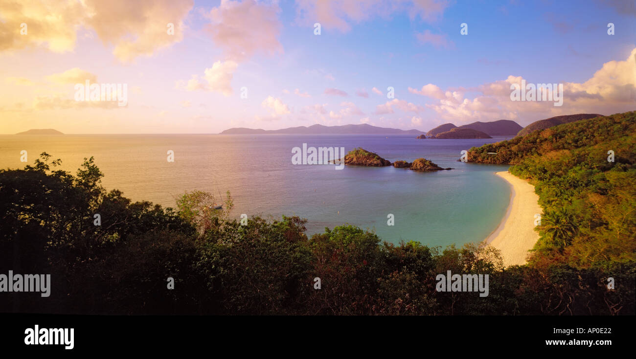 Late afternoon sun baths the white sand beach of Trunk Bay on the Caribbean island of St John in golden light - Stock Image