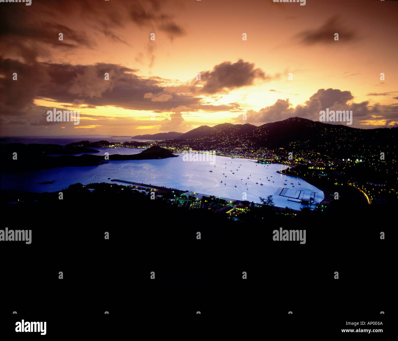 Lights of Charlotte Amalie Bay At sunset with Purple Sky and Clouds St Thomas US Virgin Islands Stock Photo